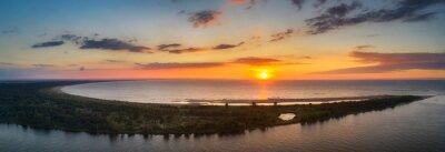 Fototapeta A beautiful sunset on the beach of the Sobieszewo Island at the Baltic Sea. Poland