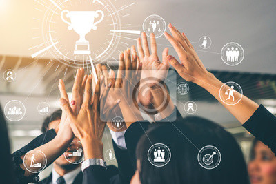 Fototapeta Achievement and Business Goal Success Concept - Creative business people with icon graphic interface showing employee reward giving for business success achievement.