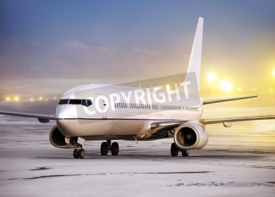 Fototapeta airport and white plane at non-flying weather, winter time