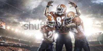 Fototapeta Američtí fotbalisté v akci na panoramatické pohledy stadionu