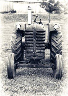 Fototapeta An Old Farm Tractor - Lightly Toned
