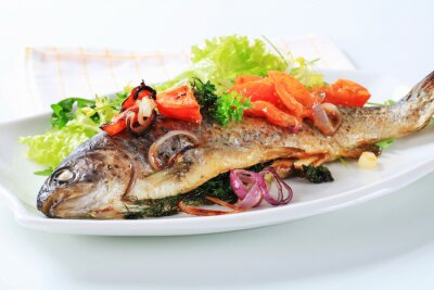 Fototapeta Baked trout with tomatoes and green salad