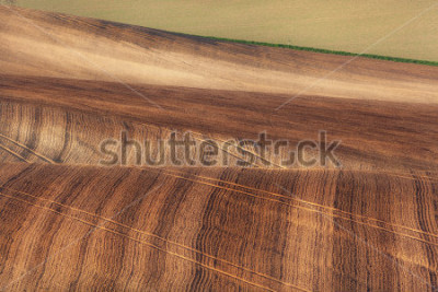 Fototapeta Beautiful concept landscape with striped fields of South Moravia at sunset, abstract background