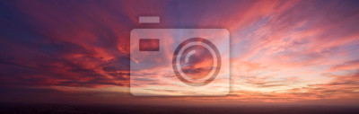 Fototapeta Beautiful dark orange sky evening beauty and Clouds at sunset , dawn, the rays of the sun break through the clouds. Natural