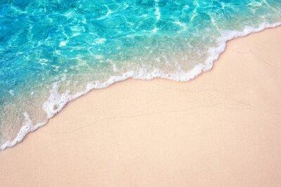 Fototapeta Beautiful Soft blue ocean wave on fine sandy beach