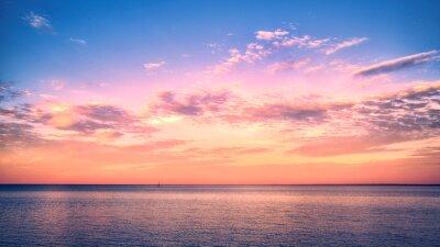 Fototapeta Beautiful sunset over Lake Superior with a sail boat