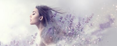 Fototapeta Beauty model girl with lavender flowers . Beautiful young brunette woman with flying long hair profile portrait. Fantasy watercolor