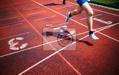 Fototapeta běžec dosáhl cílové čáry