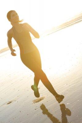 Fototapeta Běžící na pláži