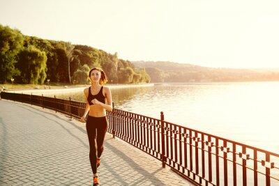 Fototapeta Běžící žena.