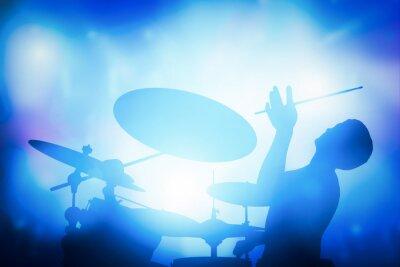 Fototapeta Bubeník hraje na bicí na koncertu hudby. klub světla