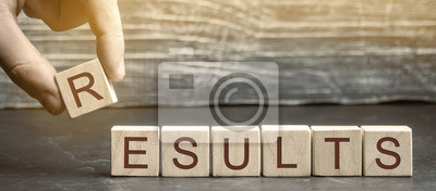 Fototapeta Businessman puts wooden blocks with the word Results. The concept of annual financial statements. Analysis of profits and revenues in the company. Achievements of the business team. Work on the errors