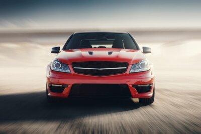 Fototapeta Červené sportovní auto rychlé rychlosti pojezdu na asfaltové silnici