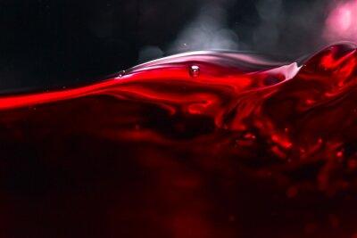 Fototapeta Červené víno na černém pozadí
