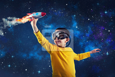 Fototapeta Child plays with a rocket. Concept of imagination