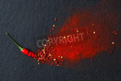 Fototapeta Chilli, paprika vločky a chilli prášek burst