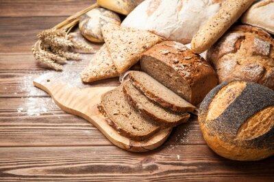Fototapeta Chléb sortiment na dřevěné desce