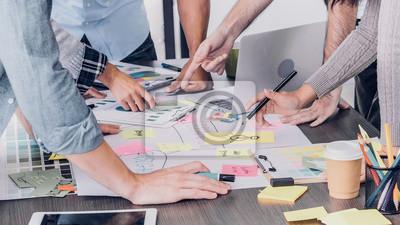 Fototapeta Close up creative designer applaud for job success at meeting table at office
