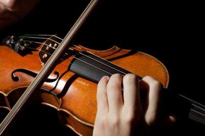 Fototapeta Close-up fotografie muž hrající na housle