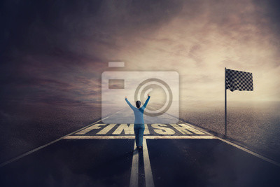 Fototapeta Competitive young woman on the road celebrate culmination raising hands up crossing the finish line. Surreal challenge winning concept, motivation and success. Opportunity way for self development.