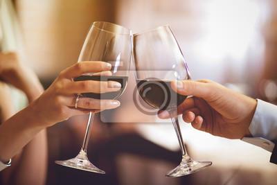 Fototapeta Couple toasting wineglasses