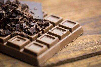 Fototapeta Dark and milk chocolate on a wooden table