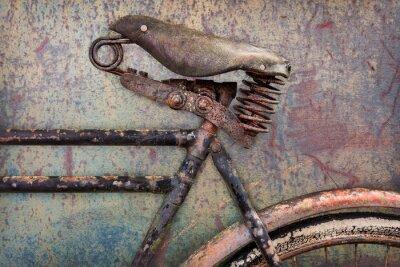 Fototapeta Detail zrezivělý starověkého kole s koženým sedlem
