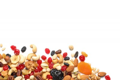 Fototapeta Different dried fruits and nuts on white background, top view. Space for text