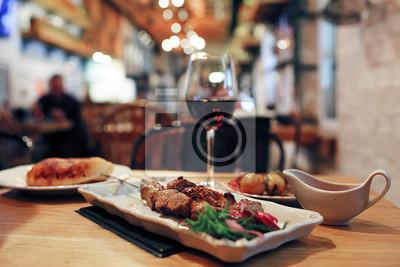 Fototapeta Dinner on the table in a cafe