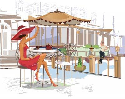 Fototapeta Dívka pití kávy v kavárně na ulici