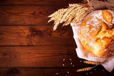 Fototapeta Domácí chléb na dřevěném podkladu. Stylu country. Jídlo pečení pozadí