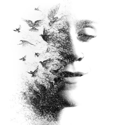 Fototapeta Double Exposure portrait of an elegant woman with closed eyes combined with hand made pencil drawing of a flock of birds flying freely resembling disintegrating particles of her being, black