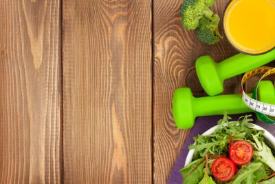 Fototapeta Dumbells, svinovací metr a zdravé výživy. Fitness a zdraví