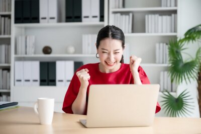 Fototapeta Excited female feeling euphoric celebrating online win success achievement result, young woman happy about good email news, motivated by great offer or new opportunity, passed exam, got a job