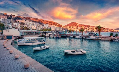 Fototapeta Fantastic spring cityscape of Saranda port. Captivating Ioninian seascape. Wonderful evening scene of Albania, Europe. Traveling concept background.
