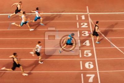 Fototapeta finish line man runners sprinters run 100 meters race athletics