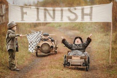 Fototapeta Finish the race between the boys on self-made cars