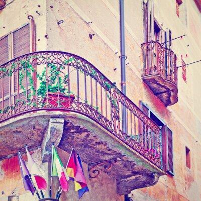 Fototapeta Flags under Balcony