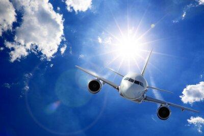 Fototapeta Flugzeug v Sonne und Wolken