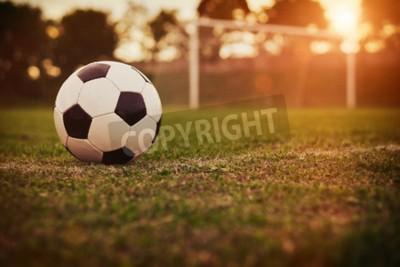 Fototapeta Fotbal v západu slunce