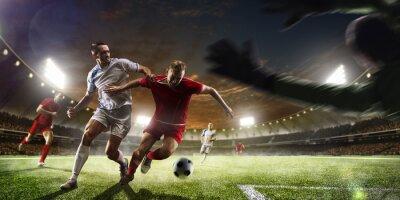 Fototapeta Fotbalisté v akci na západ stadionu na pozadí panoramatu
