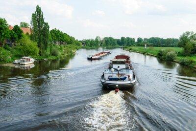 Fototapeta Frachtschiffe auf der Weser bei Nienburg
