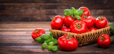 Fototapeta Fresh ripe tomatoes and basil in the basket