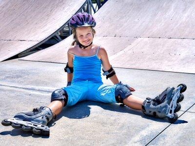Fototapeta Girl riding on roller skates .