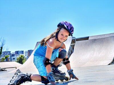Fototapeta Girl riding on roller skates in skatepark.