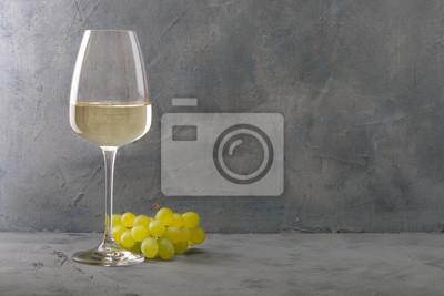 Fototapeta Glass of white wine on vintage wooden table
