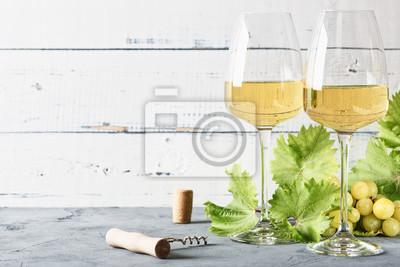 Fototapeta Glass of white wine on vintage wooden table.