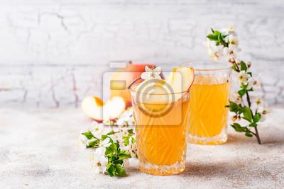 Fototapeta Glasses with fresh apple juice or cider