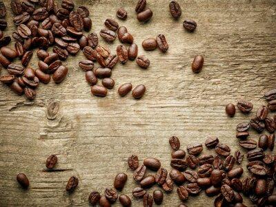 Fototapeta Kávová zrna na dřevěném stole
