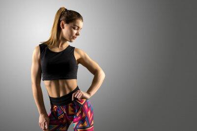Fototapeta Krásná fitness žena stojící